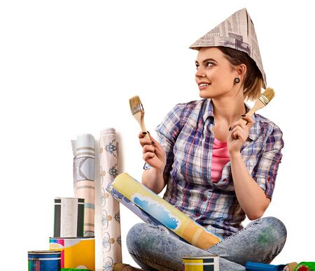 Repair home woman holding paint brush for wallpaper. Female in newspaper cap renovation apartment. Profitable loan for repairs. Student earns extra money at construction site.