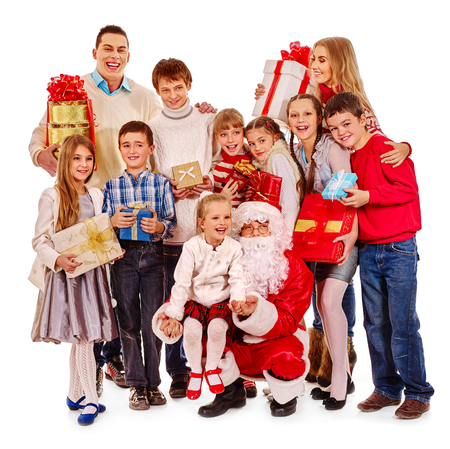 christmas spending: Christmas children group with big family and Santa Claus on Isolated. Family holding Xmas gift box is happily spending New Year party. Stock Photo