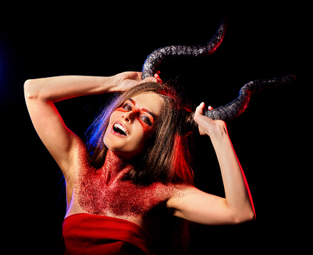 Black magic ritual of mad satan woman cry in hell on Halloween. Witch reincarnation mythical creature on Sabbath. Devil absorbing soul. Mythical zodiac Horoscope Capricorn Aries, Astral entities. Stock Photo