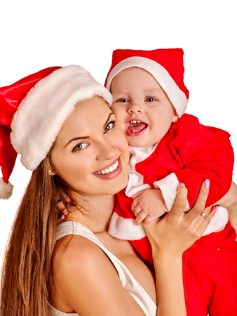 Christmas family of single parent mother and baby in Xmas hat on home party on isolated. New Year discounts for childrens products idea.