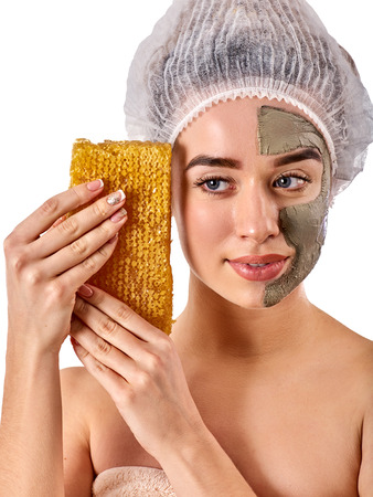Facial honey clay face mask for woman. Honeycombs natural homemade organic threatment. Skincare health concept on isolated. Removing black dots.