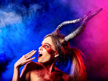 Mad satan woman on black magic ritual of in hell. Witch reincarnation mythical creature on Sabbath. Devil on Halloween. Zodiac astrology. Make-up for night club. Visions of drug addict. Astral travel. Stock Photo