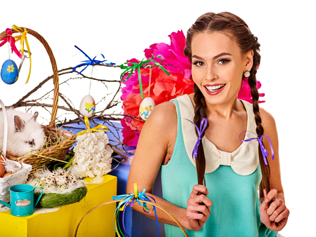 Easter dresses for women. Girl with bunny background. Woman with holiday hairstyle and make up holding rabbit in eggs basket with flowers festival. Easter and spring discounts on products for women. Banque d'images