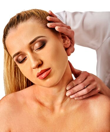 Shoulder and neck massage for woman in spa salon. Doctor making neck therapy in rehabilitation center on isolated. Skin rejuvenation.