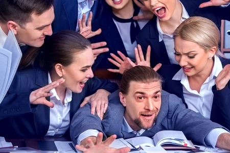 Business people office. Team people are unhappy with their leader. Intern man manager does not cope with his duties. Crowd in stress throw up their chiefs papers. Photosession memory.