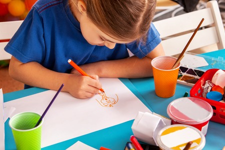 Small students painting in art school class. Child drawing by paints on table. Boy and girls in kindergarten. Girl dreams of enrolling in art school. Art childrens school.