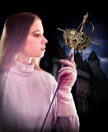 Fencing sport for women fencer. Fia female athlete in fight epee competition in historical medieval castle with lens flare illumination. Girl of noble birth.