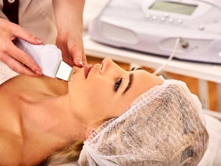 Skin care of ultrasound facial peeling. Ultrasonic cleansing procedure. Crop of beauty treatment of woman. Beauty cosmetology in spa salon. Best spa clinic.