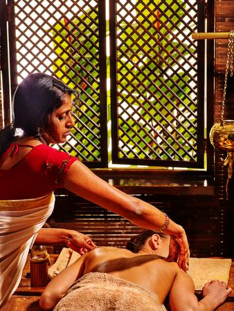 Woman having Ayurveda massage in India massagte salon. Stock Photo