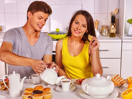 Happy couple breakfast at kitchen. Joint preparation of breakfast.