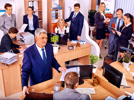 Happy group business people in office. Old man.