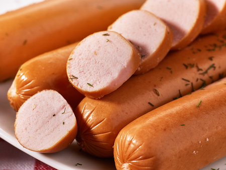 Sausages cut into pieces with spice close up