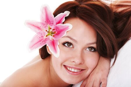 Girl with flower in hair on massge in spa salon isolated. 版權商用圖片