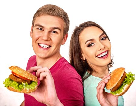 Couple eat hamburger. Women and man take fast food and commensality.