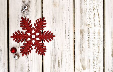 Christmas snowflake decoration and Xmas glitter ball white wooden boards. Horizontal long frame.