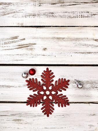 Christmas snowflake decoration and Xmas glitter ball white wooden boards. Vertical long frame and copy space.