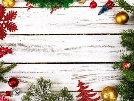 Christmas frame ball decorations and tinsel with copy space from white wooden boards. Standard-Bild