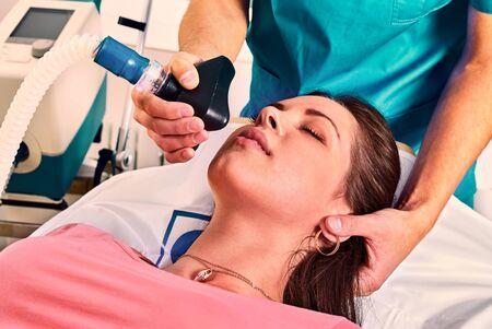Artificial ventilation apparatus oxygen mask to coronavirus on young woman patient at hospital. Medical ventilator help resuscitation with pneumonia sars virus. Close up pandemic covid 19.