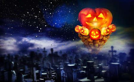 Halloween pumpkin in graveyard. Concept of jack-o-lantern pumkin tornado up over cemetery night on star sky background. 版權商用圖片