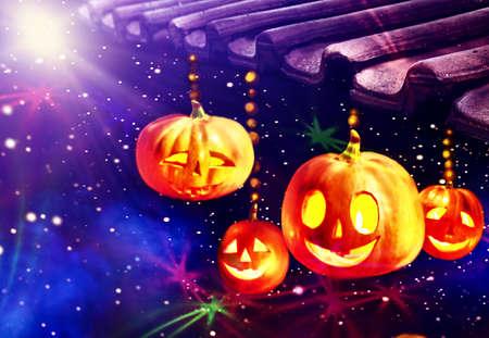 Magic jack lantern pumpkin decoration roof light on bright stars sky background. 版權商用圖片