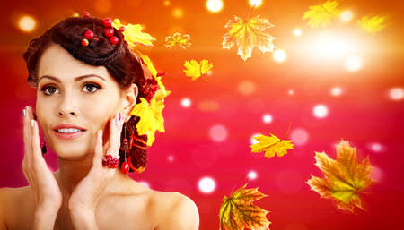 Autumn banners leaves background with beauty face and hands of beautiful woman. Fashion dream in red fall color outside. 版權商用圖片