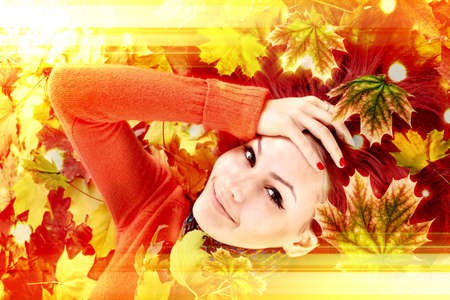 Autumn leaves light with girl. Beauty face of beautiful woman close. Fashion dream in red fall color outside. Happy person lights. 版權商用圖片