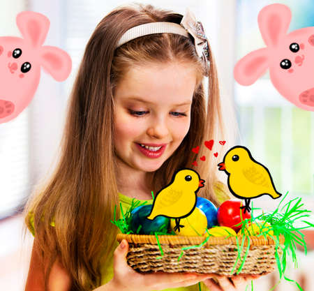 Easter happy girl child with bunny egg in nest. Kid and spring rabbit on holiday.