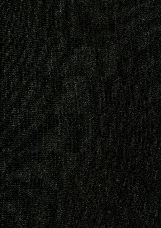 There is a close-up texture of dark knitted fabric