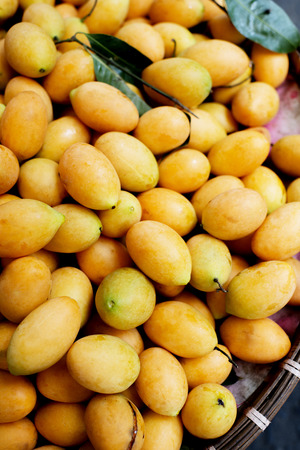 contryside: Exotic Thai Fruit, Marian plums in a big basket at an outdoor market.