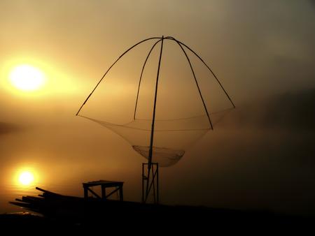 commercial fishing net: Fishing-net at sun set Stock Photo