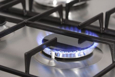 gas cooker: A flame on the gas burner.