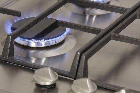 Flame gas burner on the Gas hob - closeup