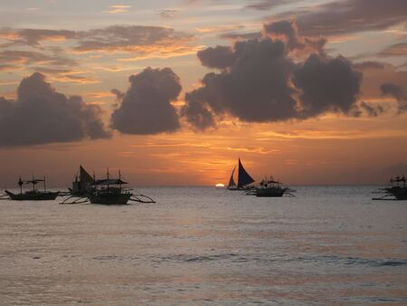 hobie: Sail boats on the ocean at sunset - Boracay Island, Philippines Stock Photo