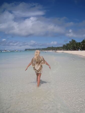 Young woman walking on an exotic beach. Boracay Island Philippines Stock Photo - 4251739