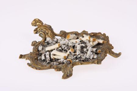Full brass ashtray isolated on white photo
