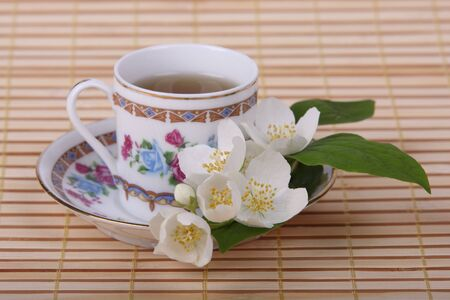 Cup of tea with jasmine flowers Stock Photo - 5120868