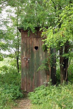 Rural old outhouse in summer - Vintage toilet. Stock Photo