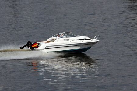 outboard: Motorboat on the river
