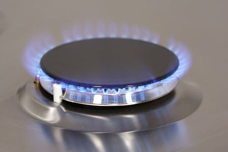 The flame of gas burner on the stove Stock Photo