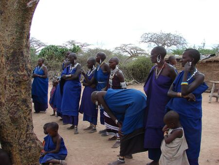 Masai performance in a traditional Masai village. The group of women watching performances by their men. Eastern Kenya Africa - 2007