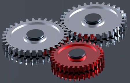 Two steel gears in connection with red one. Concept for teamwork and business. photo