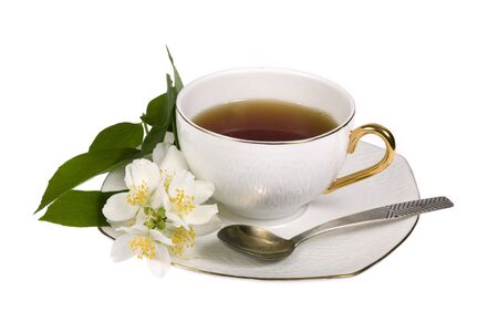 White cup of tea with jasmine flowers isolated on white.  photo
