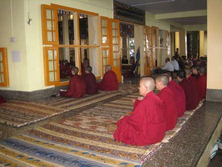 house robes: MCLEOD GANJ, DHARAMSALA - AUGUST 11: Monks on prayer in Temple on August 11, 2010 in Dharamsala, Himachal Pradesh, India Editorial