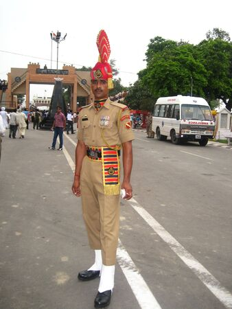 wagah: WAGAH, INDIA - JULY 31: Guard soldier during the everyday ceremonial of closing the gate on indo-pakistan border on July 31, 2010 in Wagah, Punjab, India.