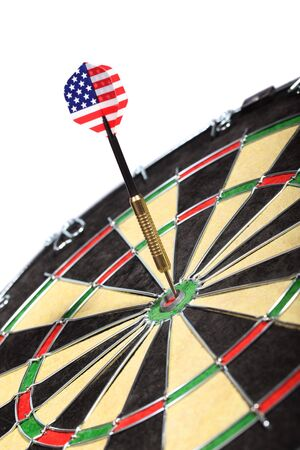 Dart with the American flag hitting a target board, concept for success and marketing. photo