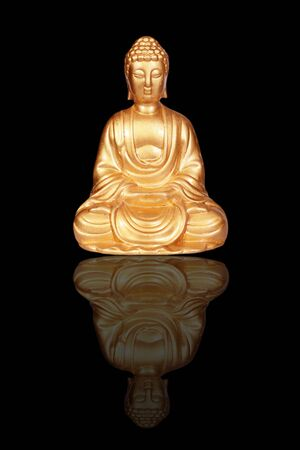 Golden Buddha statue isolated on black