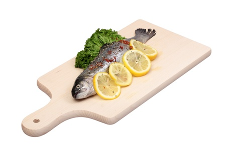 Fresh trout fish on cutting board  Stock Photo - 9590570