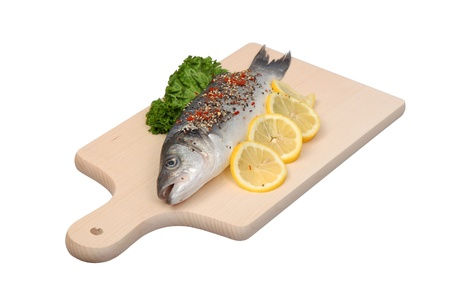 Fresh sea bass fish on cutting board photo