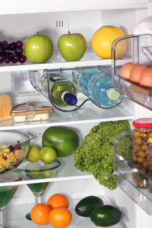 stocked: The inside of refrigerators. Full of fresh food refrigerator.