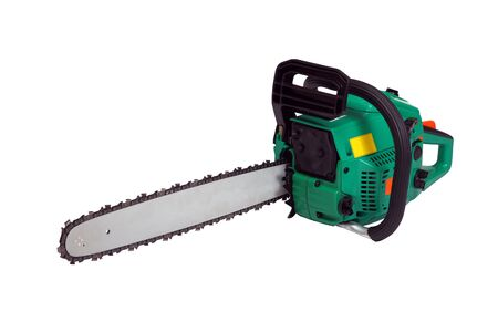 Green chainsaw on a white background. photo